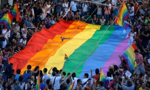 Gay rights activists carry a rainbow flag during protest at Tunel Square in Istanbul